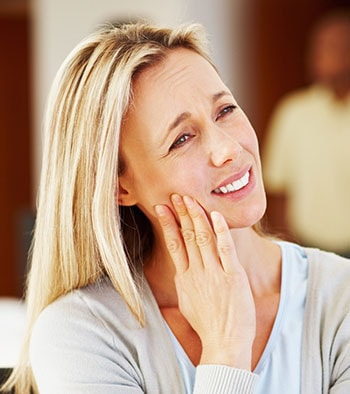 blonde woman with dental pain